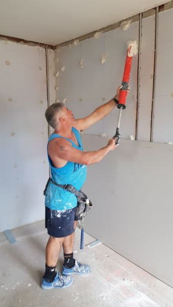 Paul from pauls plastering dry lining a wall